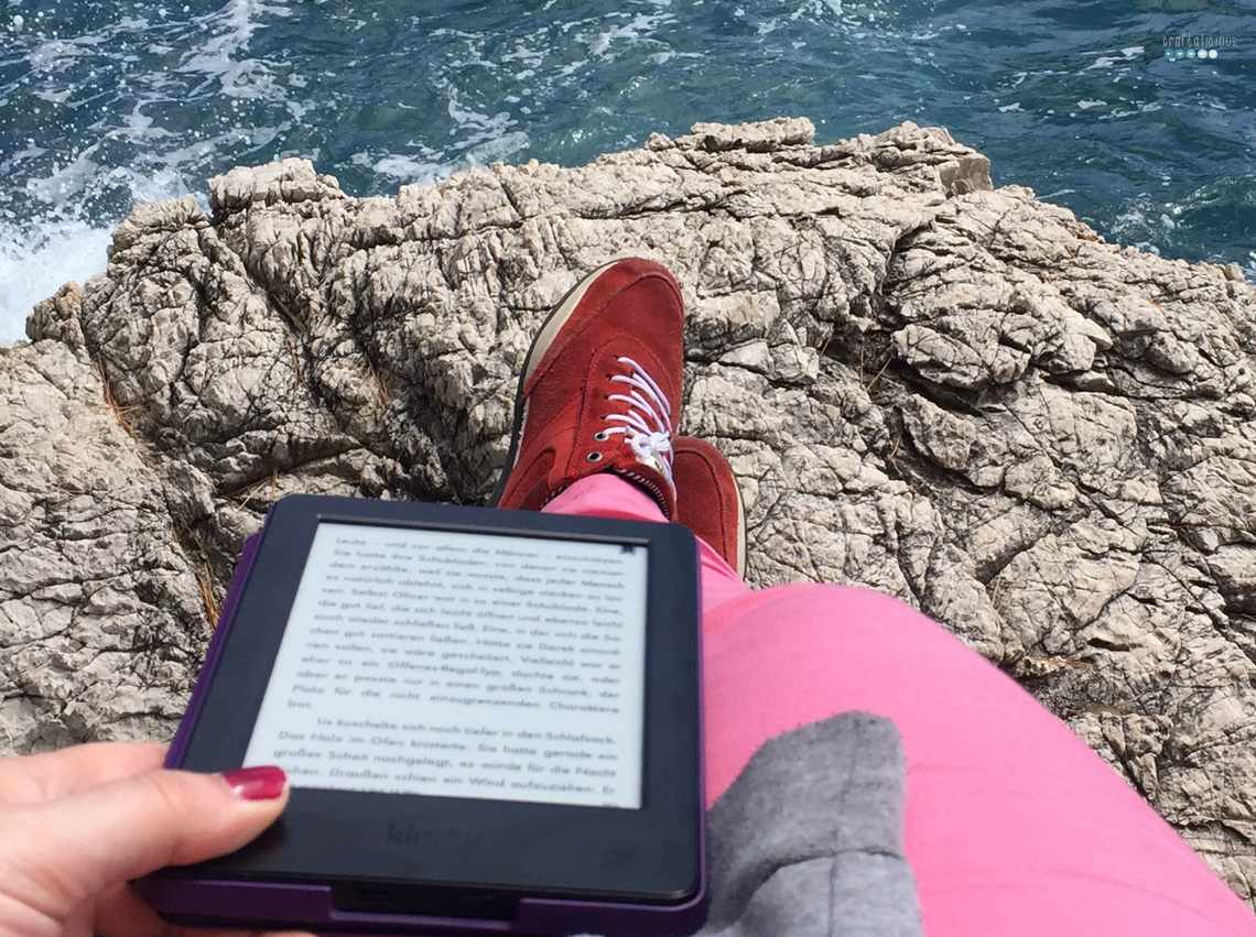 reading at the ocean